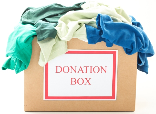 bigstock-Cardboard-donation-box-with-cl-43469368
